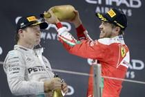 Sebastian Vettel (rechts) zal Nico Rosberg niet opvolgen bij Mercedes. © EPA.